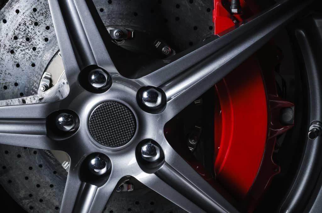 Car brakes visible through alloy wheel