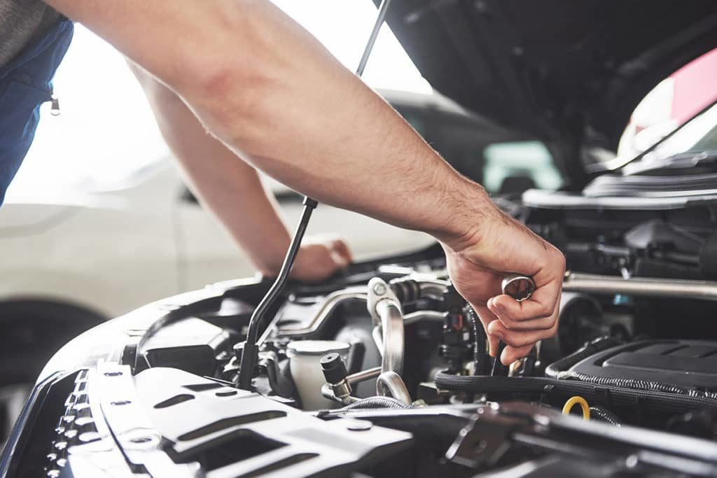 mechanic fixing a car after car diagnostics