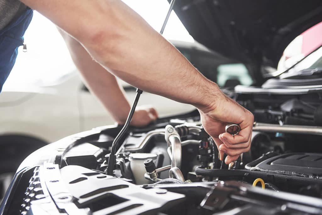 mechanic fixing a car after car diagnostics