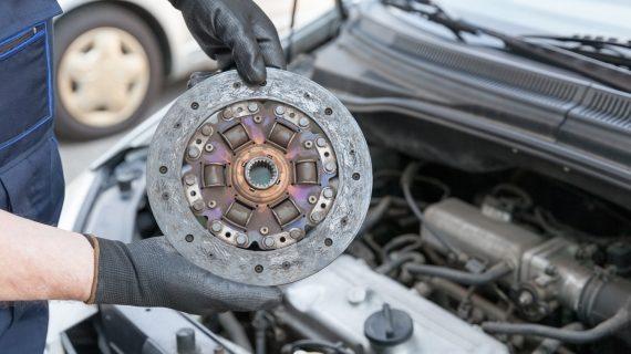 mechanic replacing a clutch